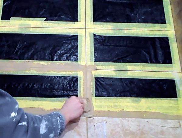 Чтобы не замарать рельефный кафель его заклеивают защитной пленкой и малярной лентой